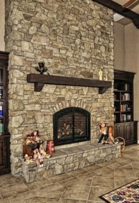 Gorgoeus Rustic Stone Fireplace With Christmas Décor 12