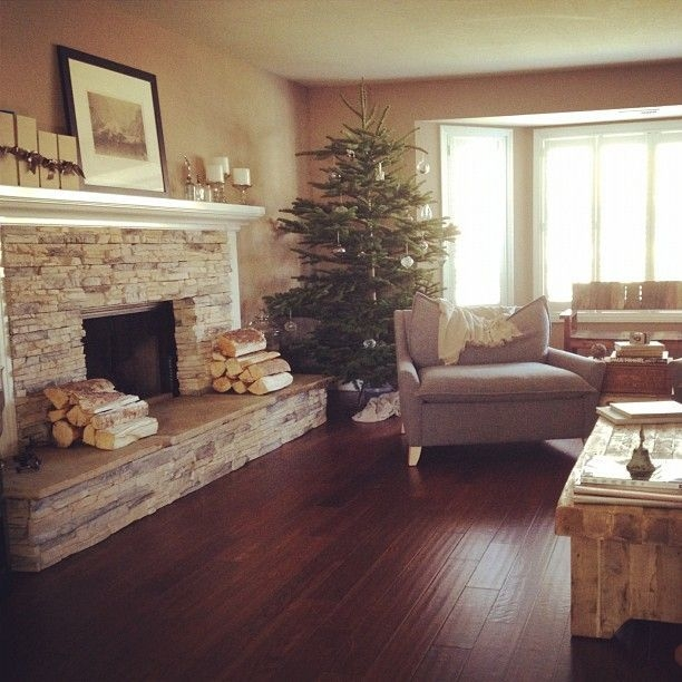 Gorgoeus Rustic Stone Fireplace With Christmas Décor 15