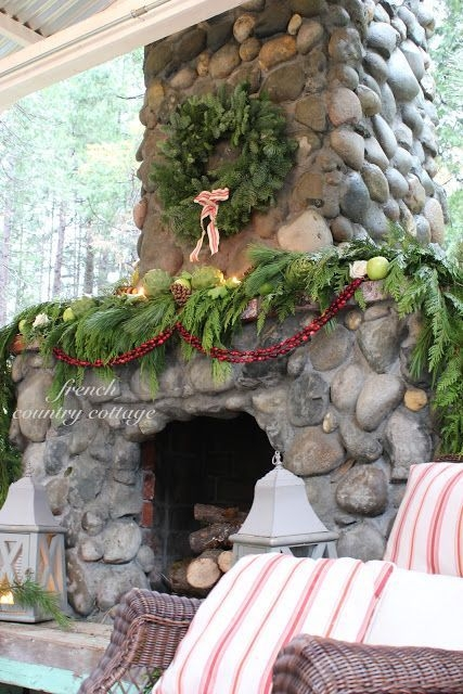 Gorgoeus Rustic Stone Fireplace With Christmas Décor 18