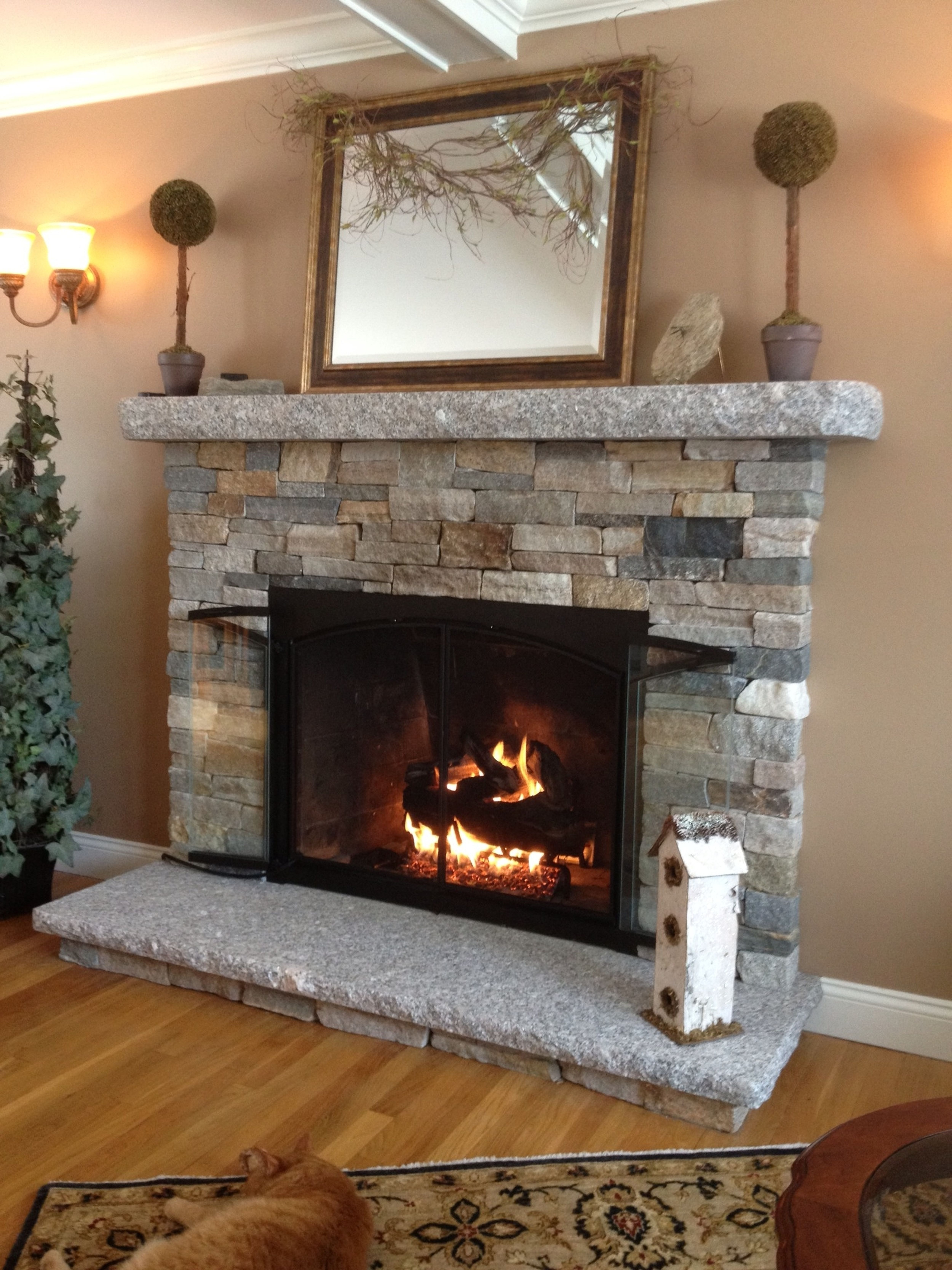 Gorgoeus Rustic Stone Fireplace With Christmas Décor 27